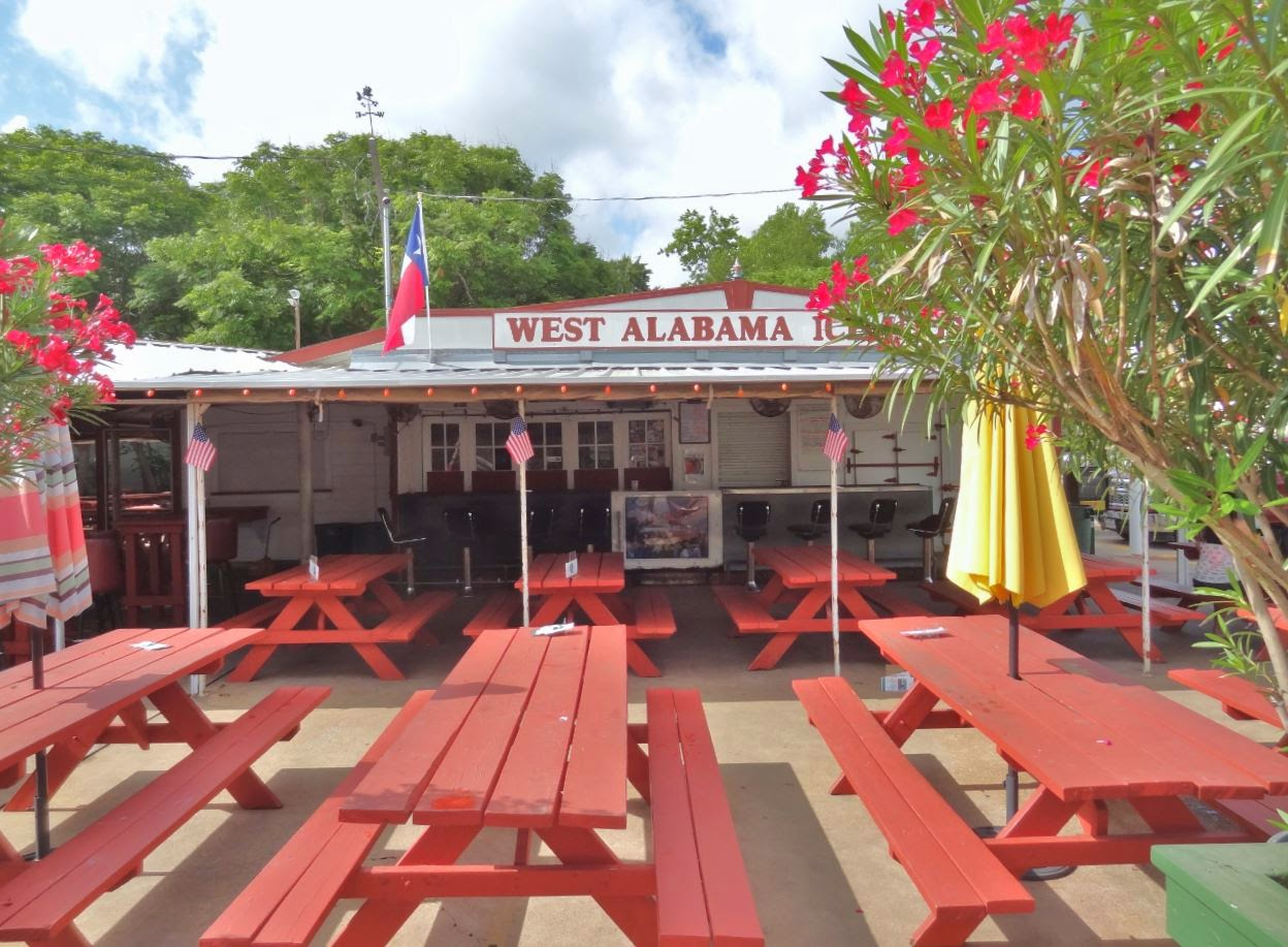 West Alabama Icehouse frontal view from street with tables-benc