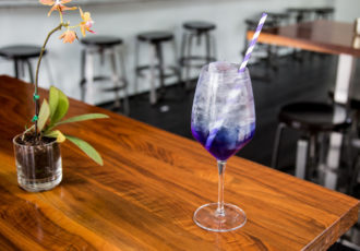 Purple Rain specialty cocktail. Photo by Becca Wright