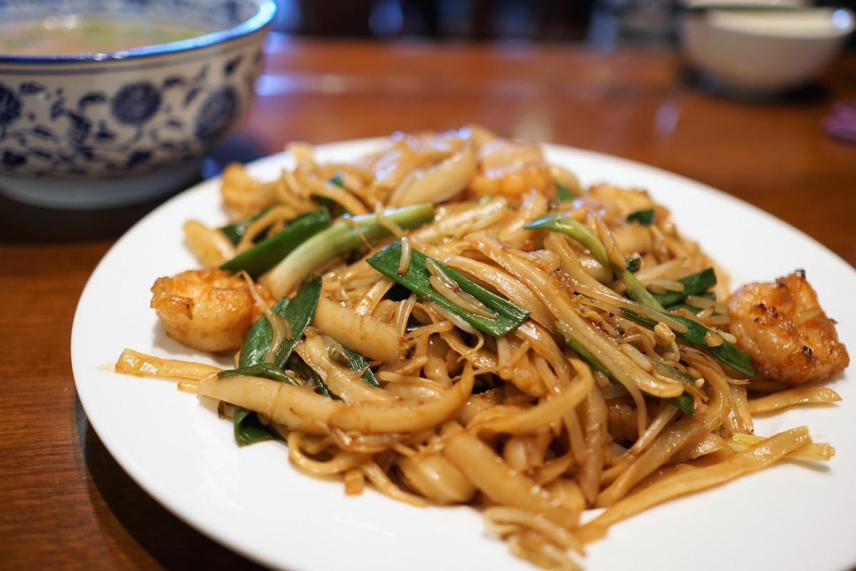 Stir-fried shrimp tossed with shaved noodles at Kuen Noodle House