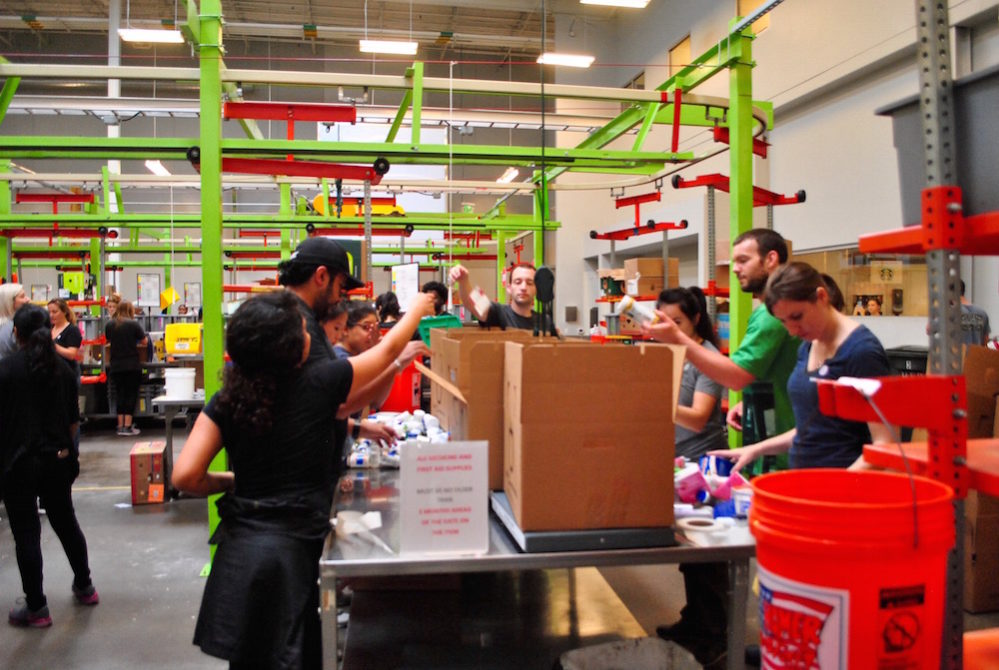 Houston Food Bank volunteers organizing packages for 600 agencies on Thursday, August 31.