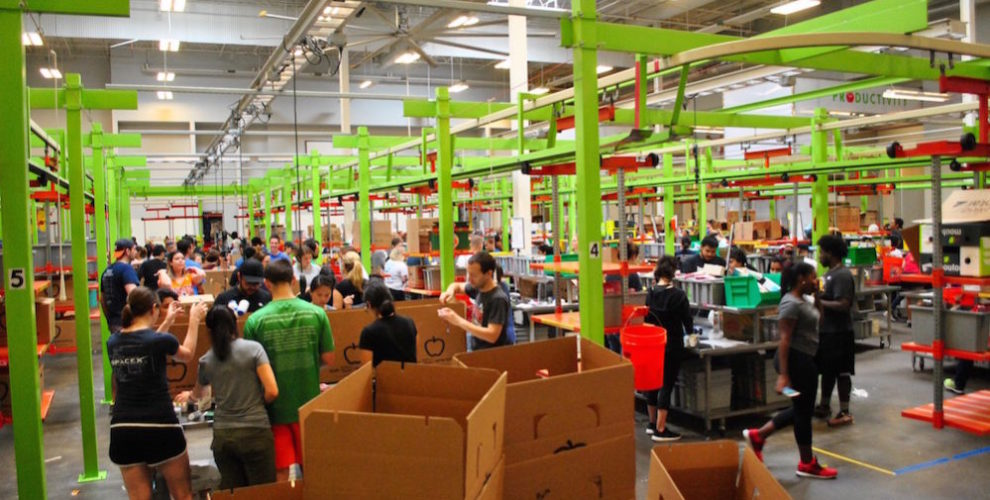 Houston Food Bank volunteers get packages boxed and organized.