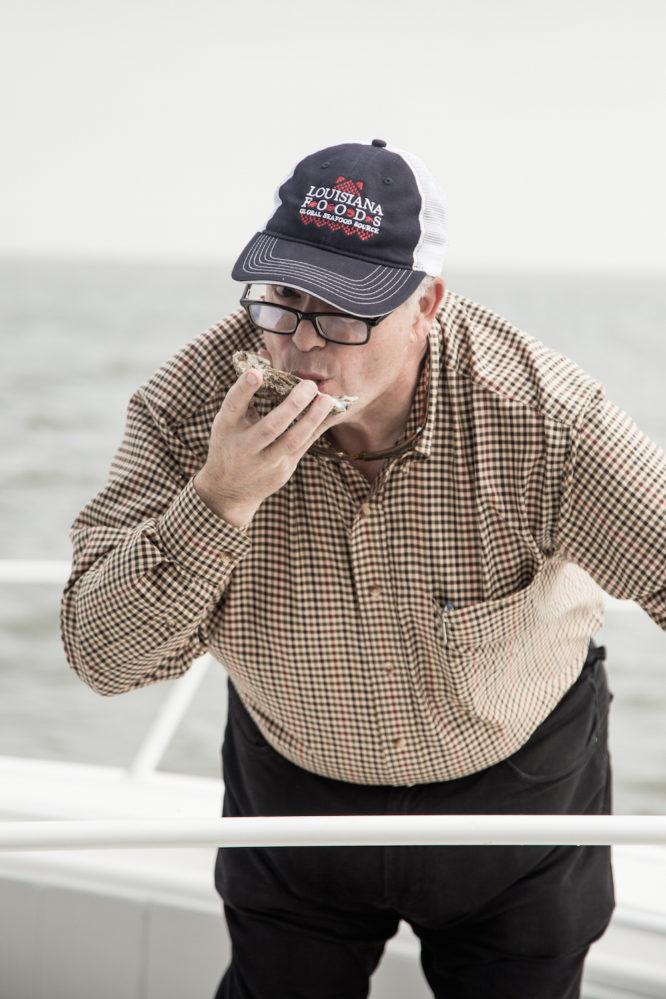 Jim Gossen slurps one down while at sea.