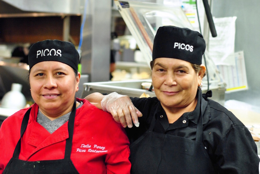 Tamale mavens in the kitchen at Picos fold thousands of tamales a week for holiday sales.
